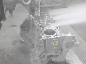 发动机增压缸盖毛刺产生原因及去毛刺工艺